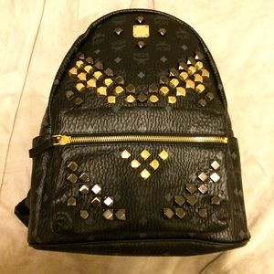 mcm medium backpack in black with studs